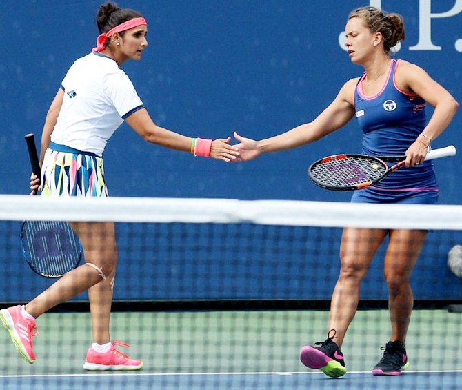 India's Sania Mirza, left, and her Czech Republic partner Barbora Strycova