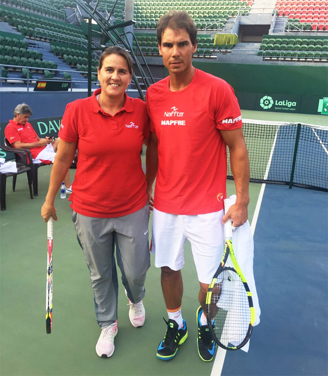Spain's Davis Cup captain Conchita Martinez (left) with Rafael Nadal before practice in New Delhi on Monday