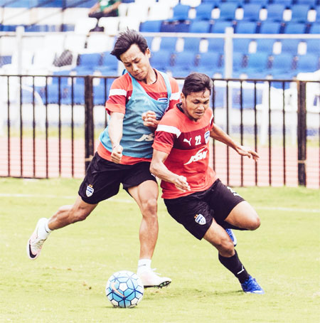 Udanta Singh takes on Nishu Kumar during a practice session on Monday