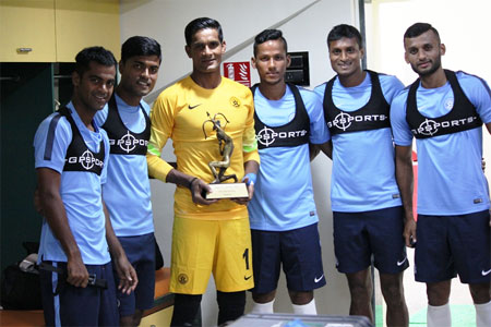 India goalkeeper Subrata Paul (centre) stands with teammates as he shows off his Arjuna Award