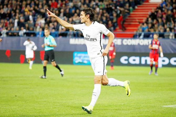 Paris Saint Germaine's Edinson Cavani celebrates a goal against Caen during their French Ligue 1 match at the Michel d'Ornano stadium in Caen, France, on Friday