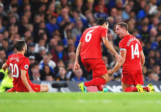 EPL PHOTOS: Henderson stunner headlines Liverpool win over Chelsea