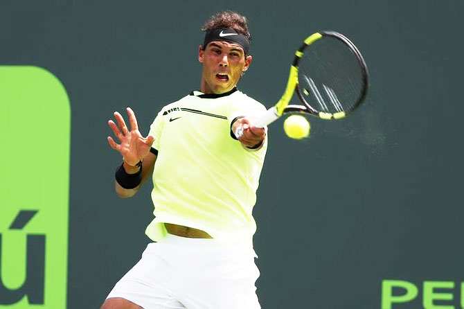 Rafael Nadal hits a forehand return against Roger Federer on Sunday