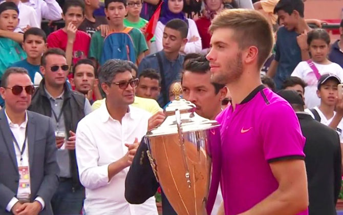 Croatia's Borna Coric poses with the trophy after winning his first ATP title in Marrakech, Morocco, on Sunday