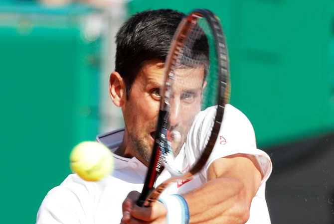 Novak Djokovic plays a return during his match against David Goffin