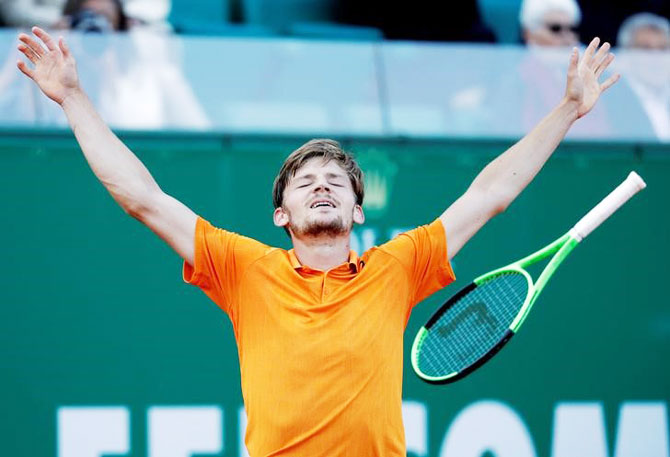 Belgian David Goffin celebrates after defeating Novak Djokovic during the Monte Carlo Masters in Monte Carlo, Monaco, on Friday