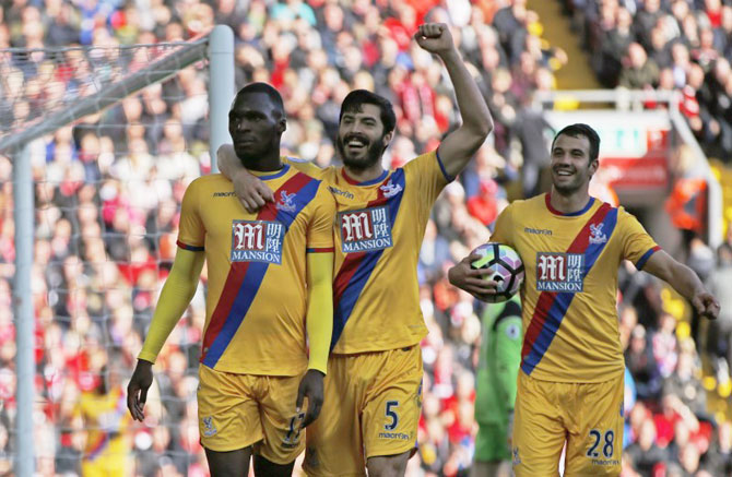 Crystal Palace's Christian Benteke (left) celebrates scoring the club's second goal with teammates during their English Premier League match against Liverpool at Anfield on Sunday