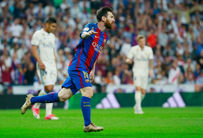 Barcelona's Lionel Messi celebrates on scoring against Real Madrid during their Clasico encounter at the Santiago Bernabeu in Madrid on Sunday