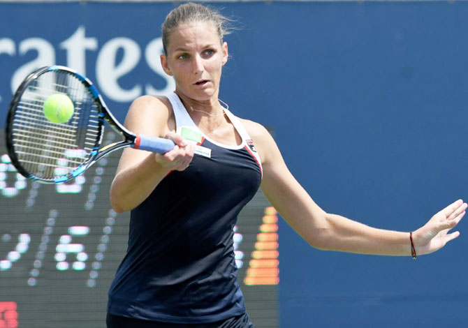 Czech Republic's Karolina Pliskova plays a shot against Japan'a Naomi Osaka during the Rogers Cup tennis tournament at Aviva Centre in Toronto, Canada