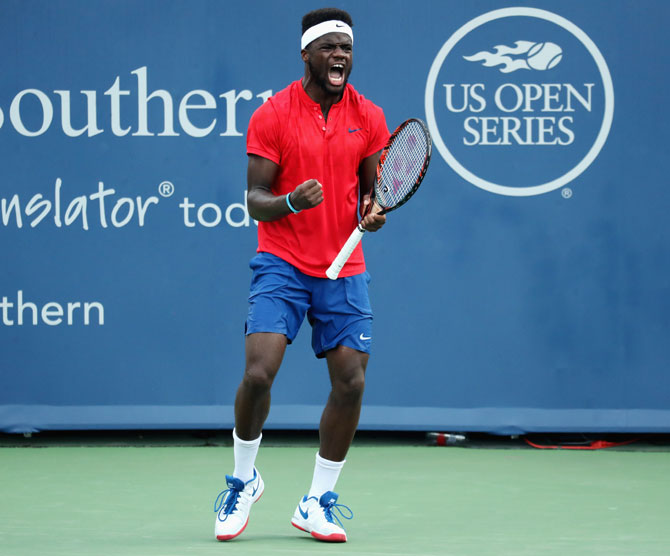 Frances Tiafoe celebrates match point after defeating Alexander Zverev