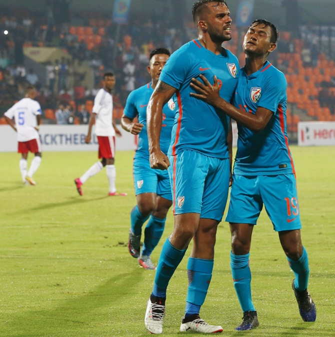 India's striker Robin Singh celebrates a goal