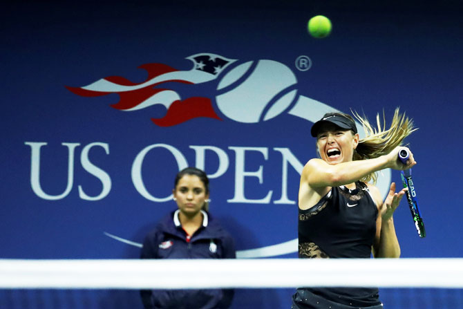 Maria Sharapova in action against Simona Halep in their first round match of the US Open at Flushing Meadows on Monday