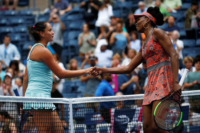 USA's Venus Williams is congratulated by Slovakia's Viktoria Kuzmova after their first round match