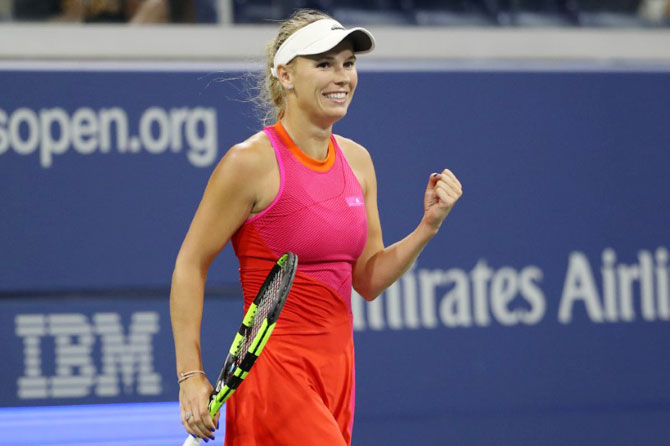 Denmark's Caroline Wozniacki celebrates after match point against Romania's Mihaela Buzemescu