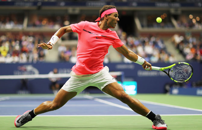 Spain's Rafael Nadal returns a shot to Serbia's Dusan Lajovic during their first round match on Day 2 of the 2017 US Open at the USTA Billie Jean King National Tennis Center in the Flushing neighborhood of the Queens borough of New York City on Tuesday