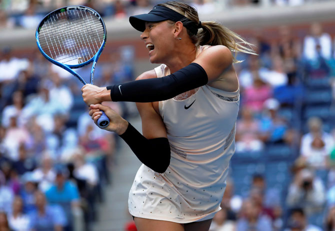 Maria Sharapova in action against Timea Babos in their second round match on Wednesday