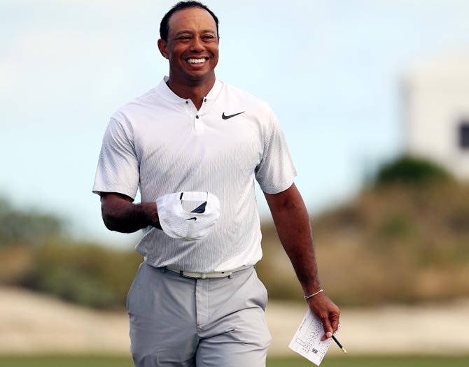 Tiger Woods walks off the 18th green after finishing the second round of the Hero World Challenge, December 2017. Photograph: Mike Ehrmann/Getty Images