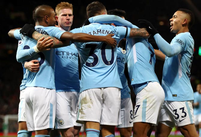 EPL PHOTOS: City down United in derby; Arsenal and Liverpool held