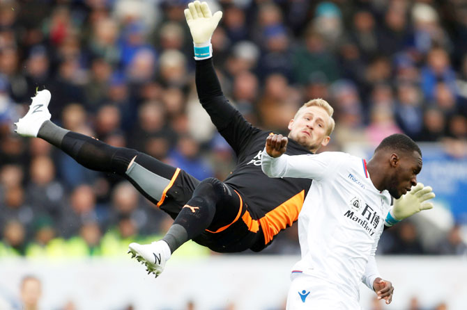 Crystal Palace's Christian Benteke fouls Leicester City's Kasper Schmeichel (left)