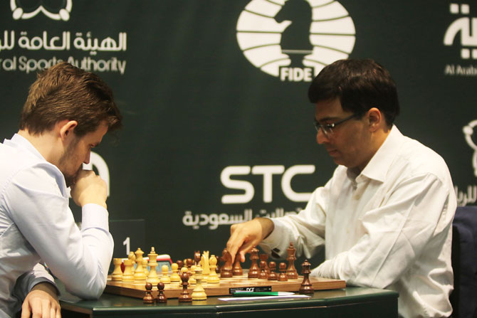 Maguns Carlsen (left) and Viswanathan Anand compete on the Day 3 of the King Salman Rapid & Blitz Chess Championships in Riyadh, Saudi Arabia, on Wednesday