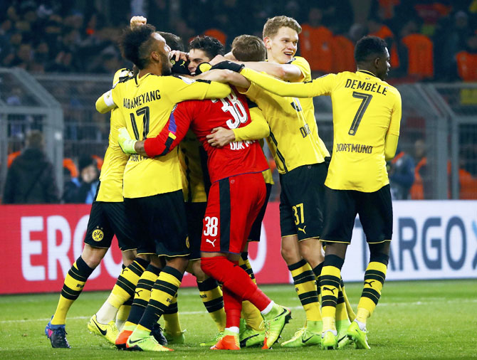 Dortmund's players celebrate after their win over Hertha Berlin in penalty shootout at Signal Iduna Park, Dortmund, on Wednesday