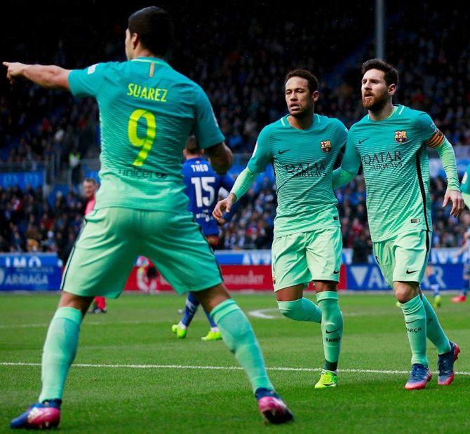 Lionel Messi, Nymar and Luis Suarez celebrate a goal