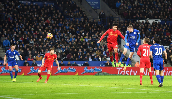 Leicester City's Jamie Vardy heads to score the club's third goal during the Premier League match against Liverpool at The King Power Stadium in Leicester on Monday