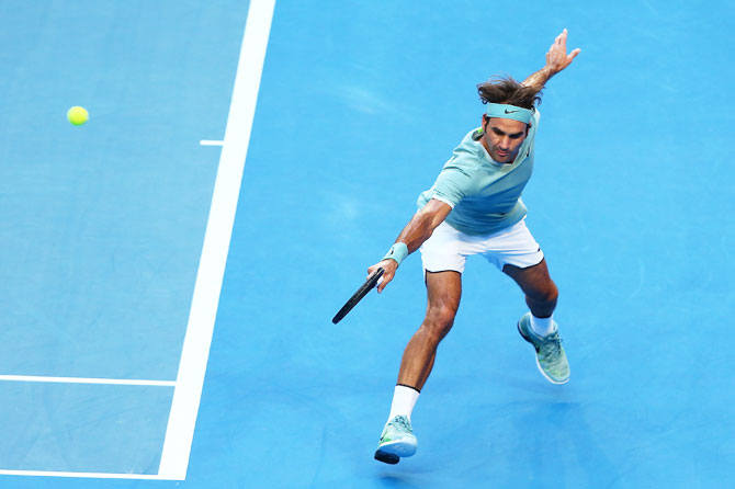 Switzerland's Roger Federer plays a backhand to Great Britain's Dan Evans in the men's singles match on Day 2 of the 2017 Hopman Cup at Perth Arena in Perth on Monday