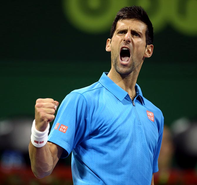 Novak Djokovic reacts after winning a point