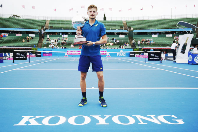 Belgium's David Goffin holds the trophy after defeating Croatia's Ivo Karlovic to win the2017 Priceline Pharmacy Kooyong Classic in Melbourne on Friday