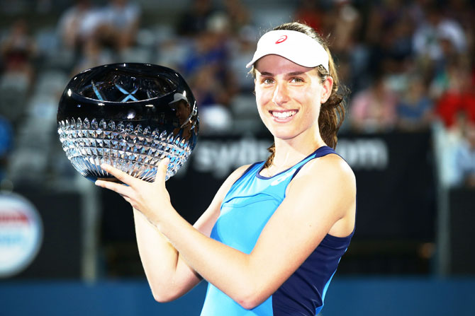 Great Britain's Johanna Konta poses with the winners' trophy after defeating Poland's Agnieszka Radwanska to win the Sydney International at Sydney Olympic Park Tennis Centre in Sydney on Friday