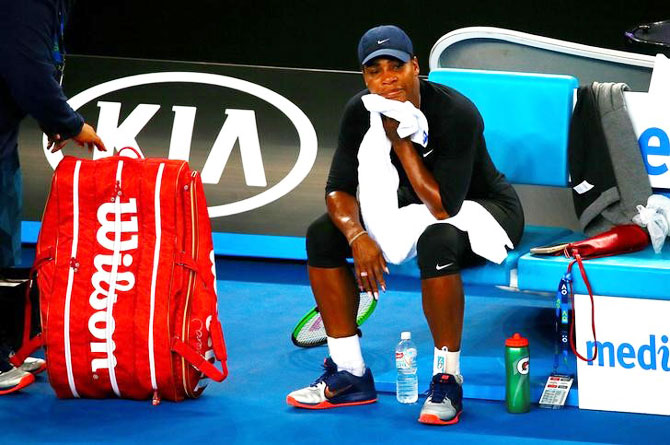 Serena Williams of the US takes a break after finishing a training session on Friday