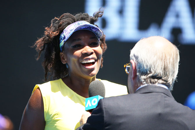 Venus Williams is interviewed after winning her second round match against Stefanie Voegele
