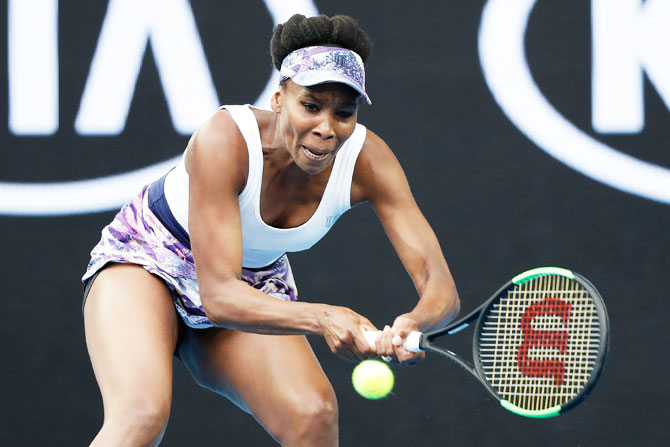 Venus Williams of the United States plays a backhand in her third round match against Ying-Ying Duan of China on Friday