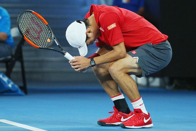 Kei Nishikori cuts a disappointed figure after missing a point during his fourth round match against Roger Federer on Sunday