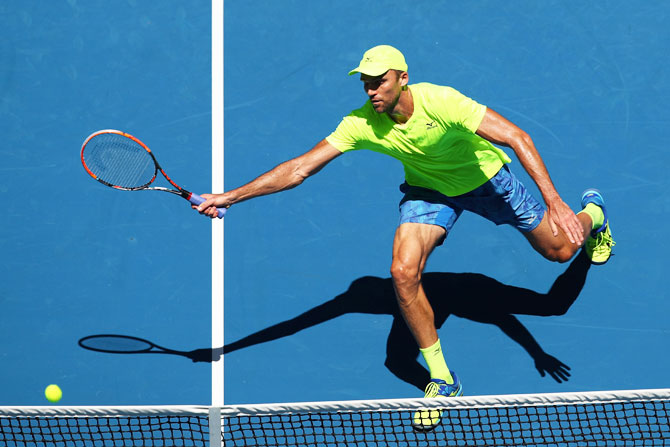 Croatia's Ivo Karlovic plays a forehand in his third round match against Belgium's David Goffin on Monday