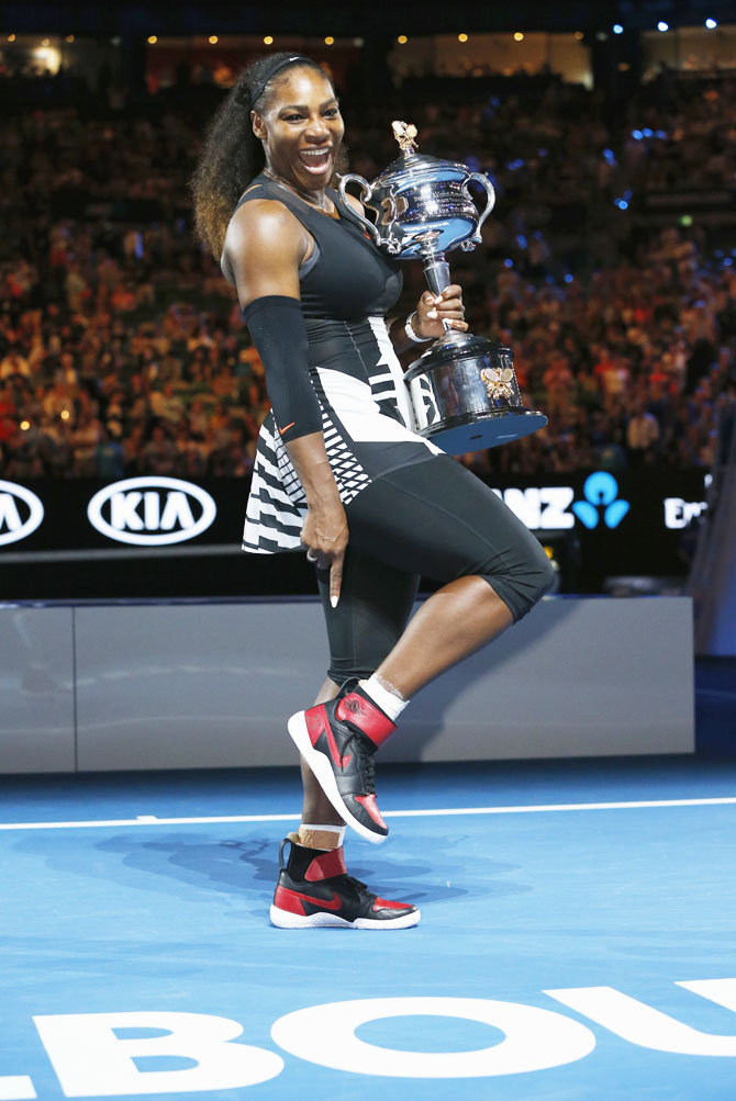Serena Williams celebrates after winning the Australian Open title in January this year