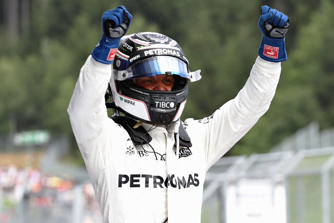 Mercedes GP's Finnish driver Valtteri Bottas celebrates his win in parc ferme during the Formula One Grand Prix of Austria at Red Bull Ring in Spielberg, Austria, on Sunday
