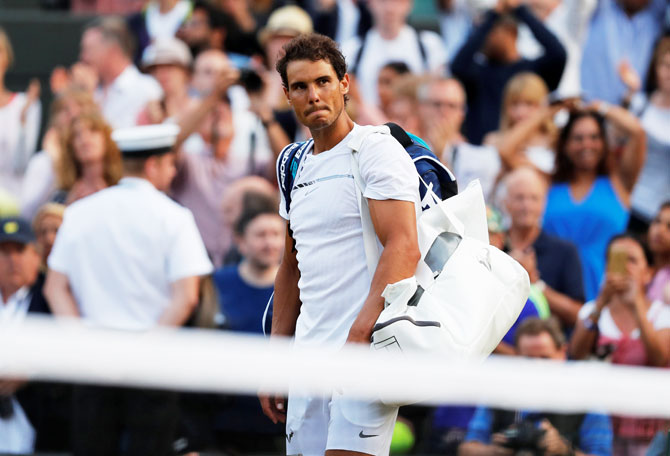 Spain's Rafael Nadal walks off the court after losing to Luxembourg's Gilles Muller in the fourth round of Wimbledon in London on Monday