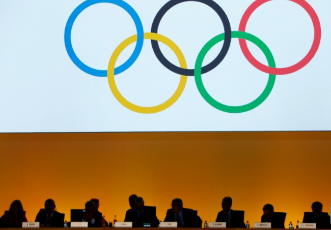 International Olympic Committee (IOC) delegates are seen during the IOC extraordinary session in Lausanne