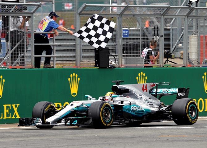 Hamilton wins British Grand Prix to slash Vettel's lead