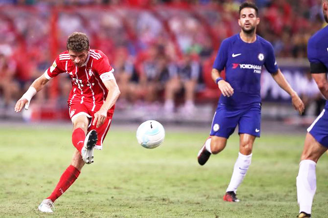Bayern Munich's Thomas Muller scores the third goal against Chelsea during their International Champions Cup in Singapore on Tuesday