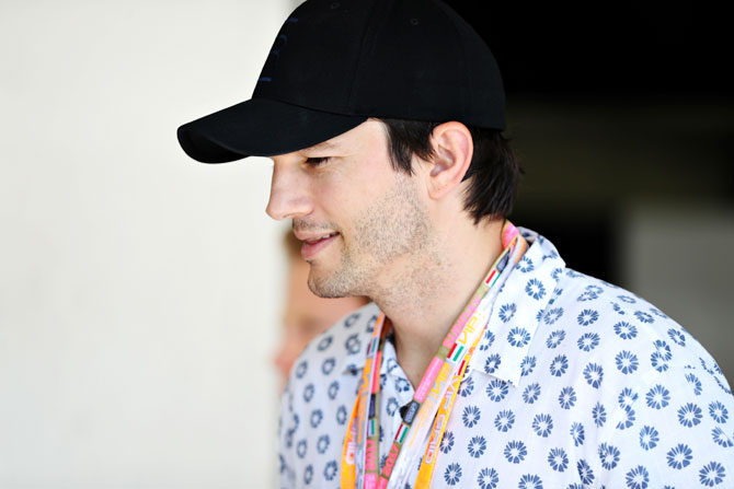 Actor Ashton Kutcher look on in the Paddock during the Formula One Grand Prix of Hungary