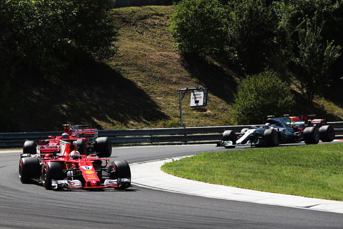 Sebastian Vettel of Germany driving the (5) Scuderia Ferrari SF70H leads the field round the second corner during the Formula One Grand Prix of Hungary at Hungaroring circuit