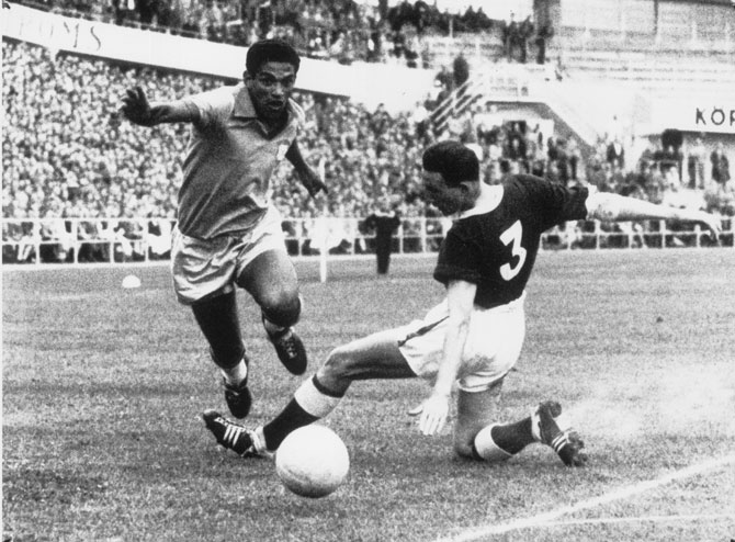 A file photo of Brazilian right winger Garrincha (left) and Welsh player Hopkins vieing for possession