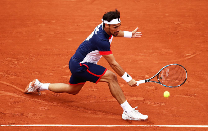Fabio Fognini plays a backhand during his match against Stan Wawrinka