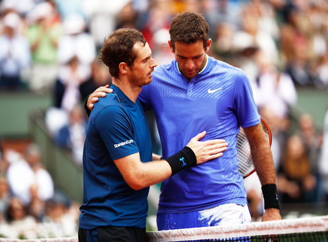 Great Britain's Andy Murray consoles Argentina's Juan Martin Del Potro after their third round match