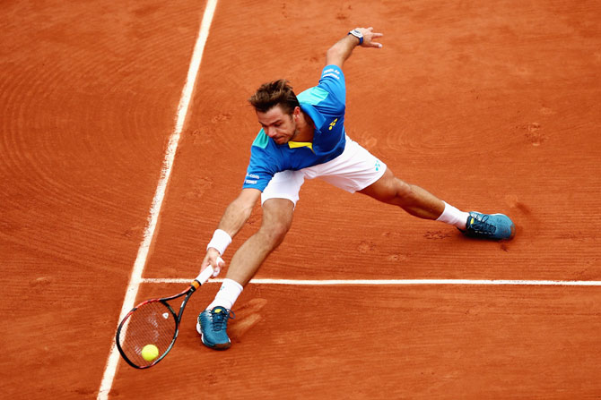 Switzerland's Stan Wawrinka  plays a forehand during the men's singles third round match against Italy's Fabio Fognini