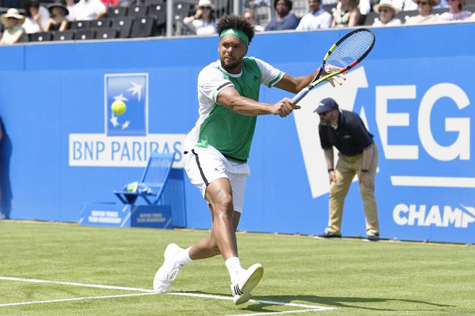 France's Jo-Wilfried Tsonga in action during his first round match against compatriot Adrian Mannarino