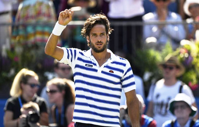Spain's Feliciano Lopez celebrates defeating Switzerland's Stan Wawrinka in the first round of the Queen's Club Aegon Championship at Queen's Club in London on Tuesday